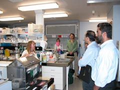 Scientists attending the Rust Diseases symposium are shown around laboratories at the Elizabeth Macarthur Agricultural Institute.